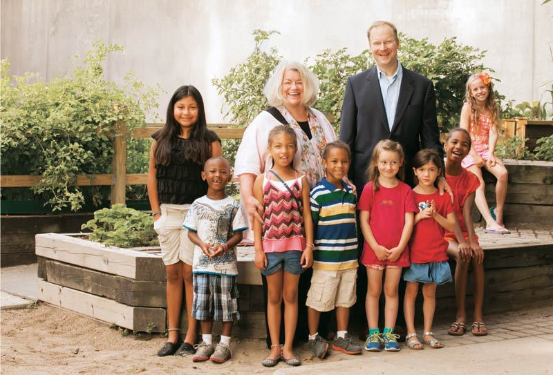 Executive Director Mary Anne Brown, Board President Eric Sorensen and some young friends from Hephzibah's Day Care program, surrounded by nature's bounty in the new Alex Anderson Memorial Garden at Hephzibah Home.