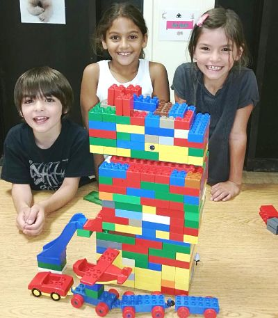 The kids at Lincoln School show off their lego creation.